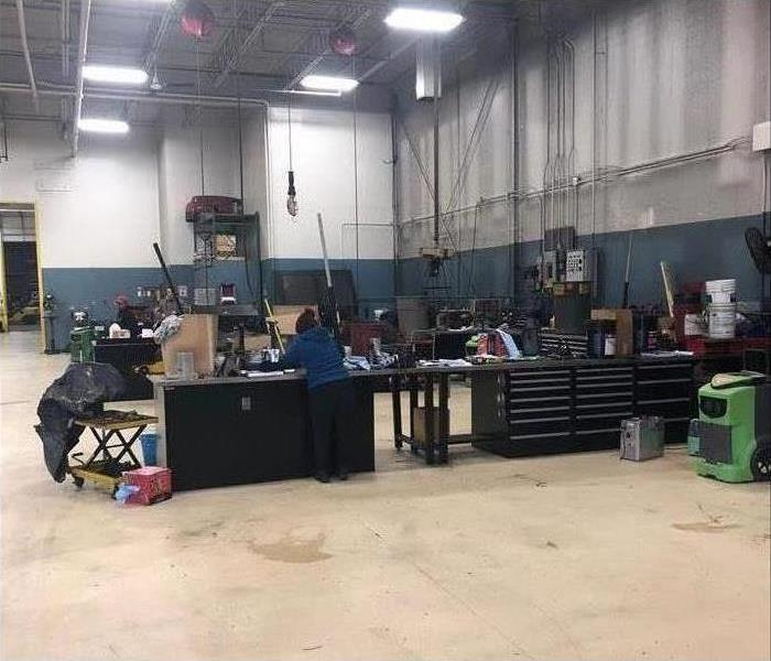 Same warehouse with work stations completely cleaned and back in working order.
