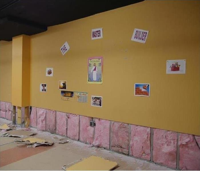 A church classroom with the first two feet of wall removed.