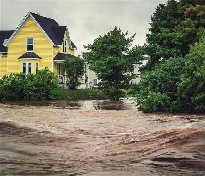 A house is surrounded by floodwater