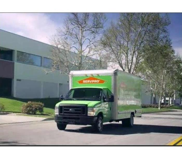 A SERVPRO truck is parked in front of an office building