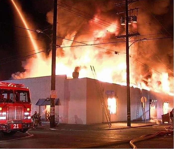 A commercial building burns at night