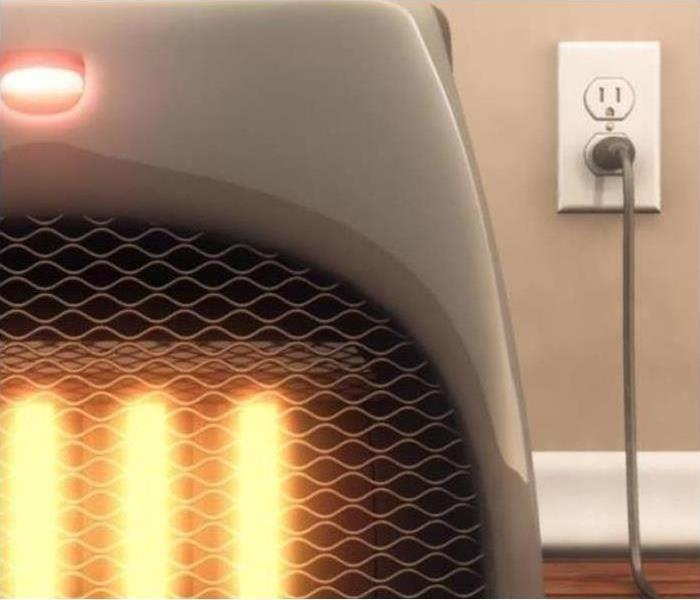 A space heater is plugged into an outlet.