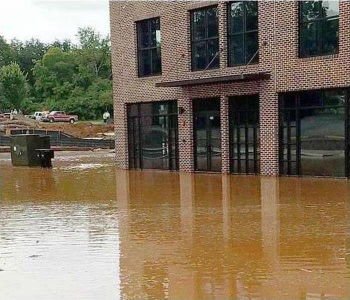 An office building is surrounded by flood water