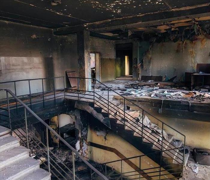 A burned-out interior of an office, stairwell and lobby