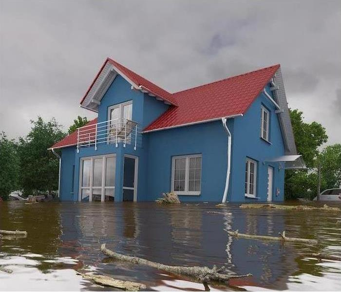 A house is surrounded by flood water