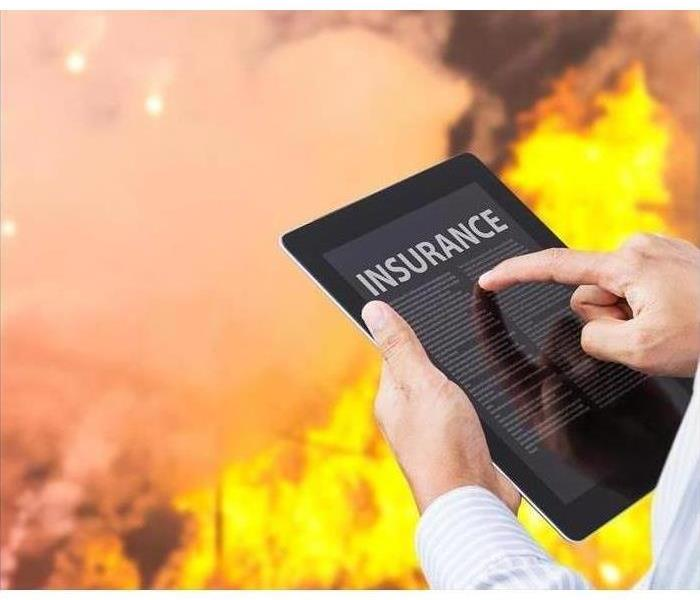 A tablet is used to document information at the site of a fire