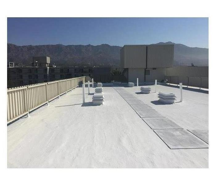 Snow lies on the roof of a large commercial facility